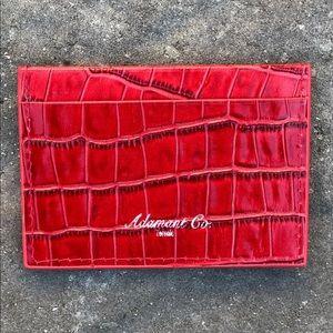 Red crocodile embossed cardholder.